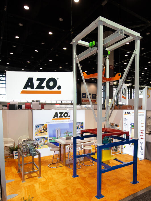 AZO booth at Pack Expo with modular color coded big bag unloader